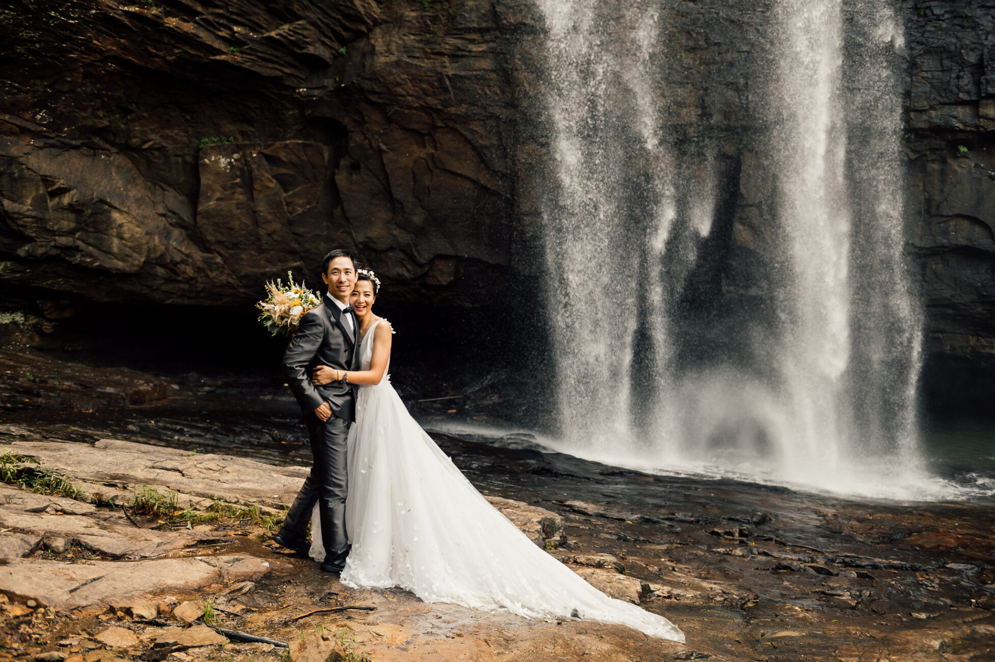 Bride and Groom pose for pictures at Lula Lake waterfall in Chattanooga