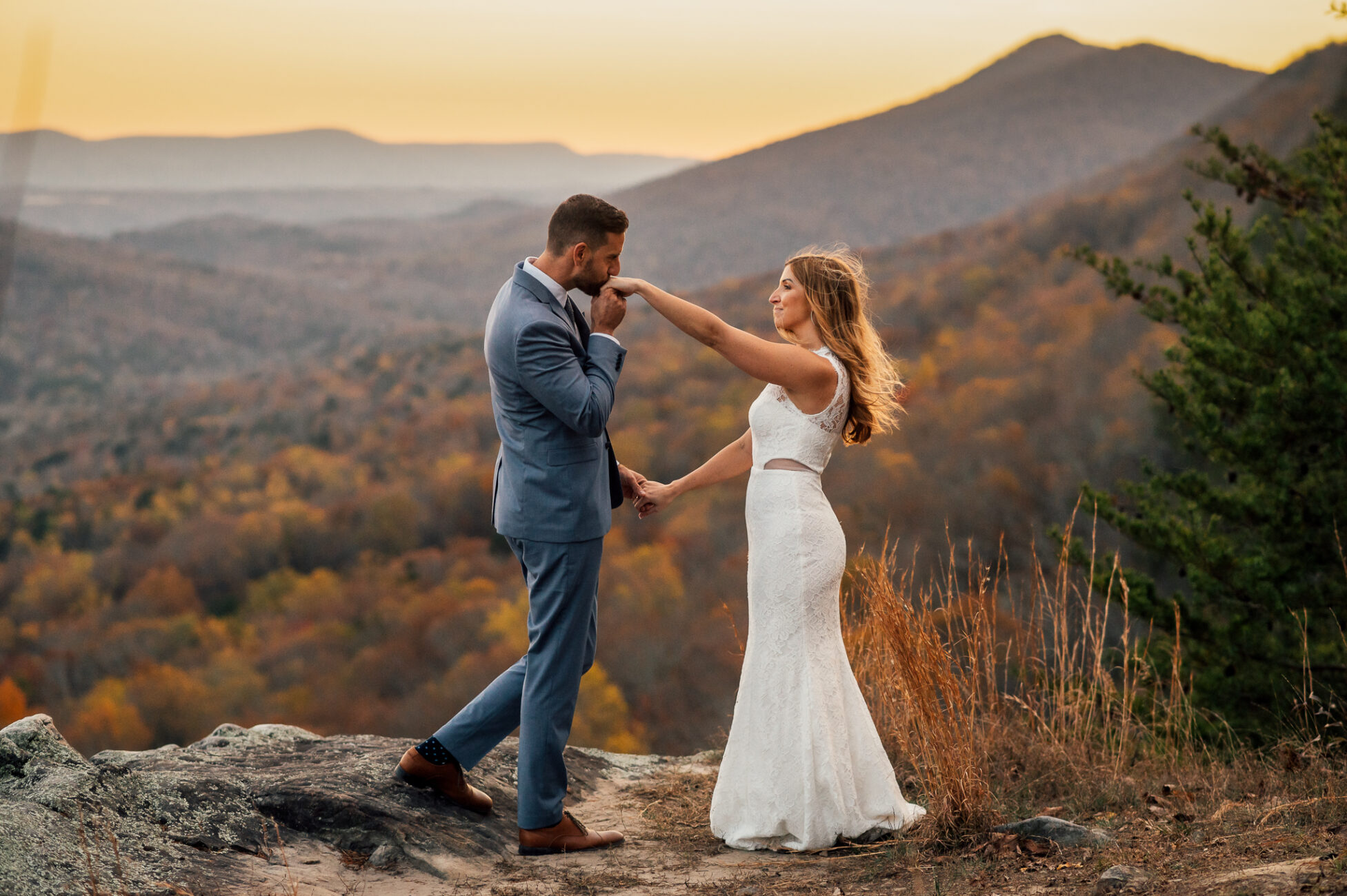 bride and groom standing at overlook at lula lake during sunset